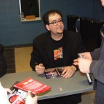 Josh signs a DVD cover